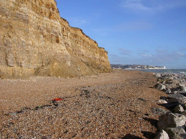 Cliffs and beach at Glyne Gap looking east