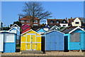 TM0112 : Beach huts and houses above by David Martin