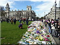 TQ3079 : Flower Tributes in Parliament Square by PAUL FARMER