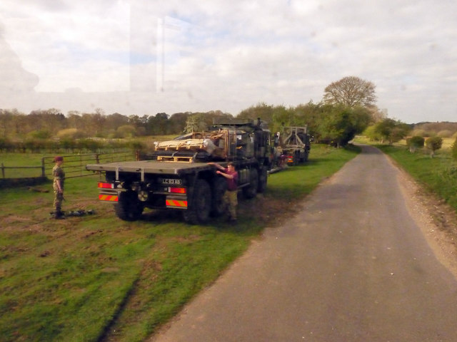 Military vehicles close to All Saints, Stanford