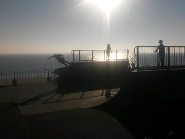 Lee-on-the-Solent: skateboarders in silhouette