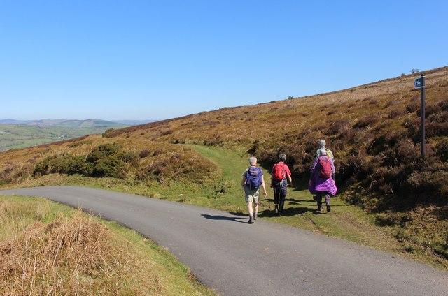 Walkers take bridleway below Llantysilio Mountain