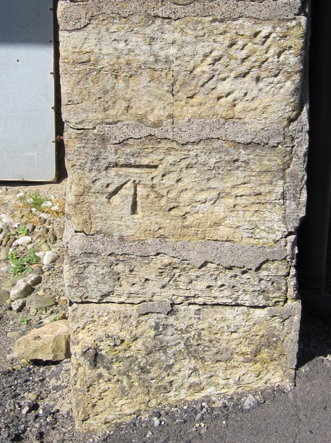 Bench mark on the barn at Four Lane Ends, Low Bentham