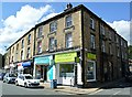 SE1422 : Commercial Street at Church Lane in Brighouse by Bobby Clegg