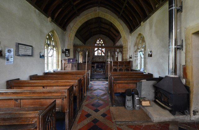 Melbury Bubb, St. Mary's Church: The nave showing the coal fire for heating