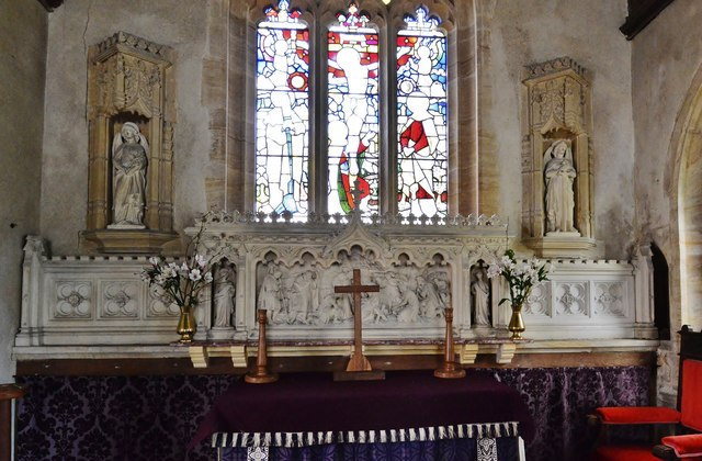 Melbury Bubb, St. Mary's Church: The chancel with its carved reredos and odd faux niches