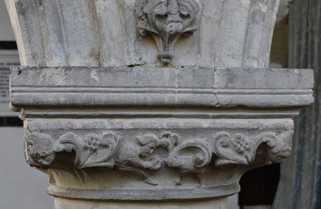 Hawkchurch: St. John the Baptist's Church: Nave capital, man feeding an animal