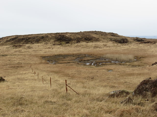 Fence posts on the boggy moorland at Airig a' Bhreac Laoigh