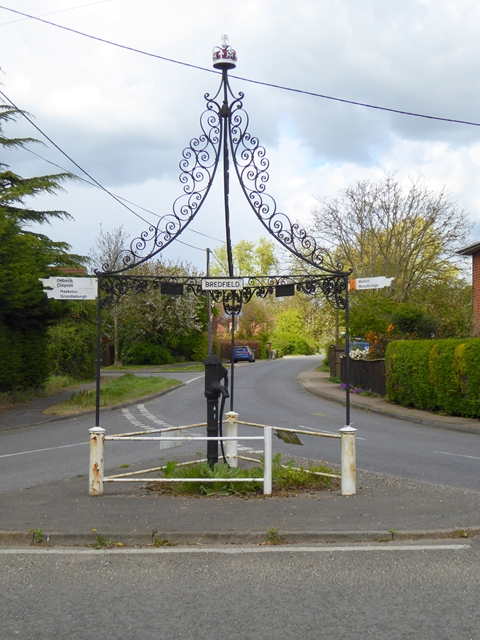 Village pump and signpost
