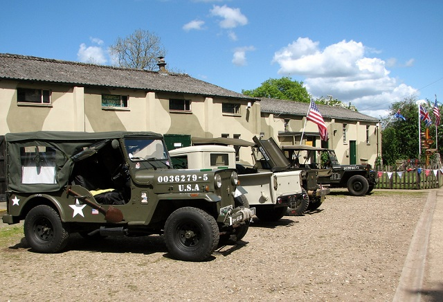 Military vehicles parked at the gymnasium