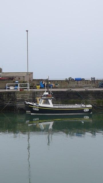 Small 'Montrose Register' fishing boat in Gourdon Harbour