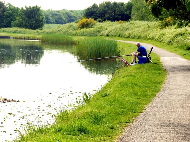 A lone fisherman on the Leeds to Liverpool Canal
