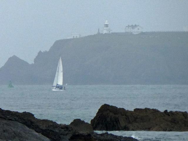 A hazy St. Ann's Head lighthouse from Angle