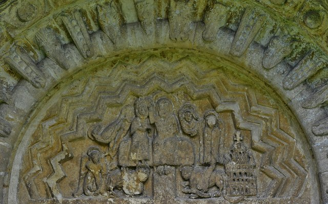 Quenington, St. Swithuns Church: The Norman south doorway tympanum