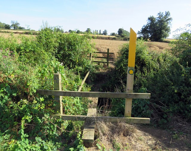 Stiles and bridge on footpath to Gaddesby