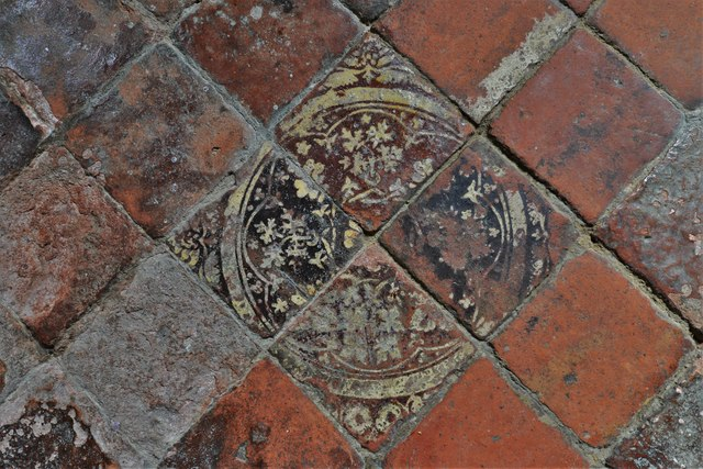 Buckland, St. Michael's Church: Well worn c15th tiles in the south aisle 1
