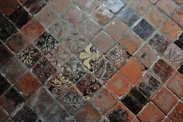 Buckland, St. Michael's Church: Well worn c15th tiles in the south aisle 3