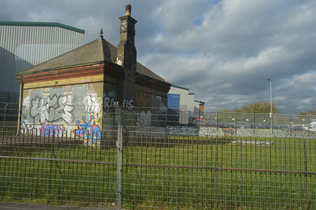 Graffitied trackside building