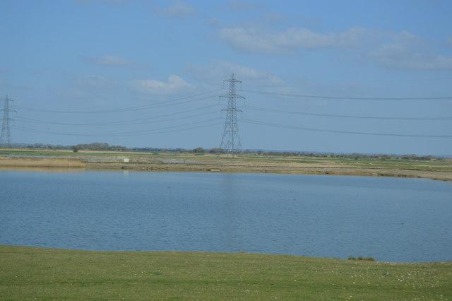Flooded gravel pit and pylon