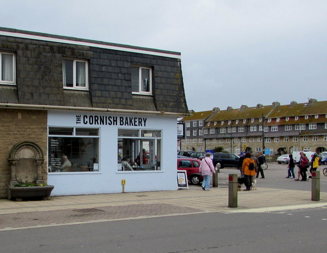 The Cornish Bakery and a Grade II listed old fountain, West Bay, Dorset