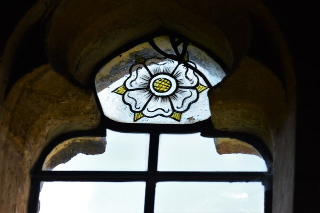 Stanton, St. Michael's Church: The white rose of York in the c15th west window (ca. 1480)