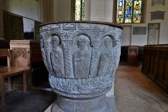 Rendcomb, St. Peter's Church: c12th Norman font, depicting eleven disciples with the tools of their trades 1