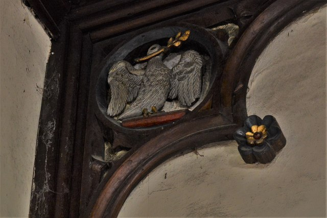 Rendcomb, St. Peter's Church: Dove carving in the roof supporting timbers