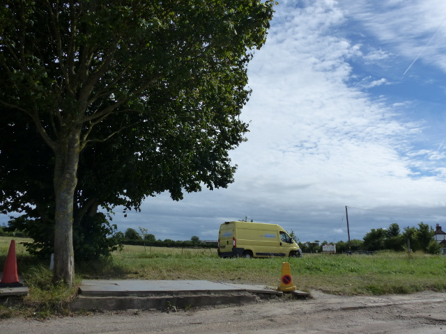 A van on the A38, passing a layby