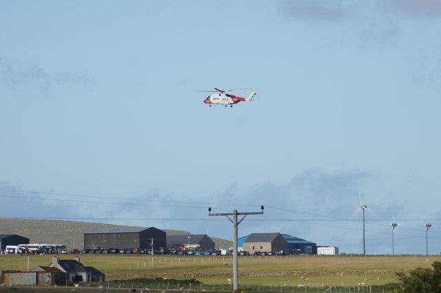 Coastguard Rescue helicopter Oscar Charlie over Baltasound