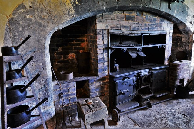 Chastleton House: Range and assorted pans in the Old Kitchen