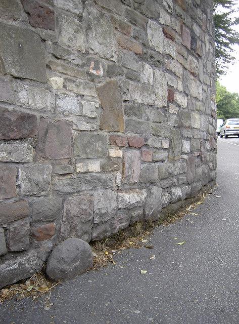 A sinking boundary stone