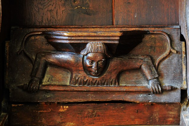 Swinbrook, St. Mary's Church: Medieval choir stall with misericord in the chancel 3