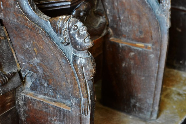 Swinbrook, St. Mary's Church: Carvings on the armrests of the medieval choir stalls 1