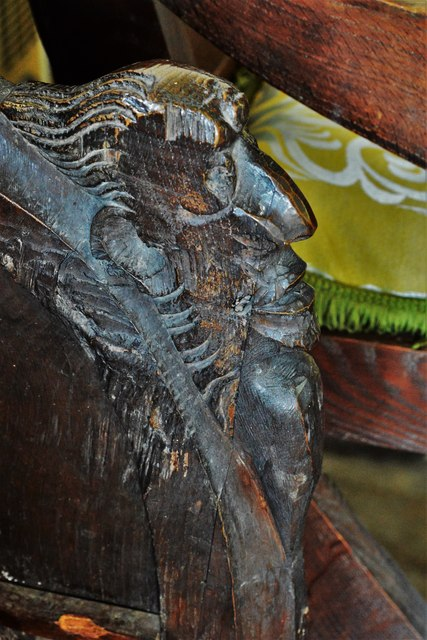 Swinbrook, St. Mary's Church: Carvings on the armrests of the medieval choir stalls 4