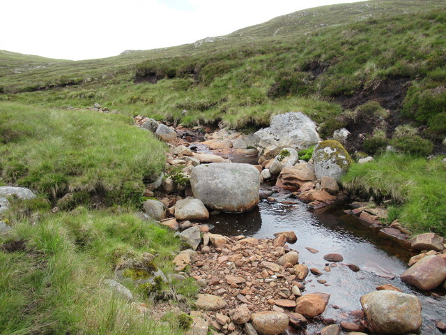 Boulders in the streambed of Allt Feith a' Mhoraire high above upper Speyside