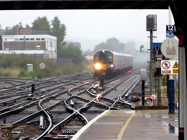 A train approaching Eastleigh station in pouring rain