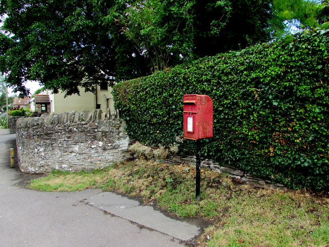 Queen Elizabeth II postbox and a hedge, Nibley Lane, Nibley, South Gloucestershire