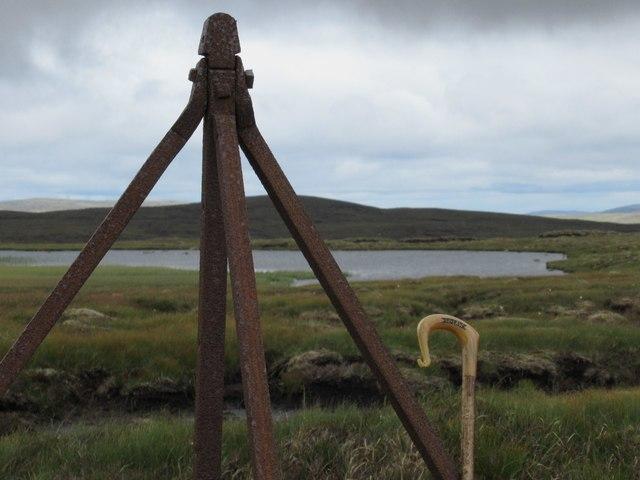 Big tripod straining post in fence above upper Speyside