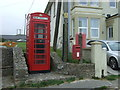 SW5230 : Elizabeth II postbox and telephone box on Trevenner Square, Marazion by JThomas