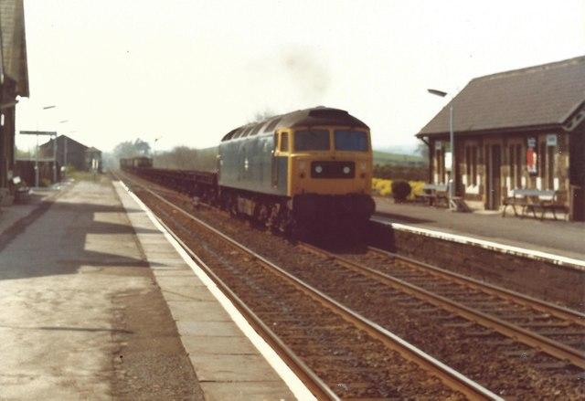 Brush type 4 Class 37 hauls a down freight through Settle