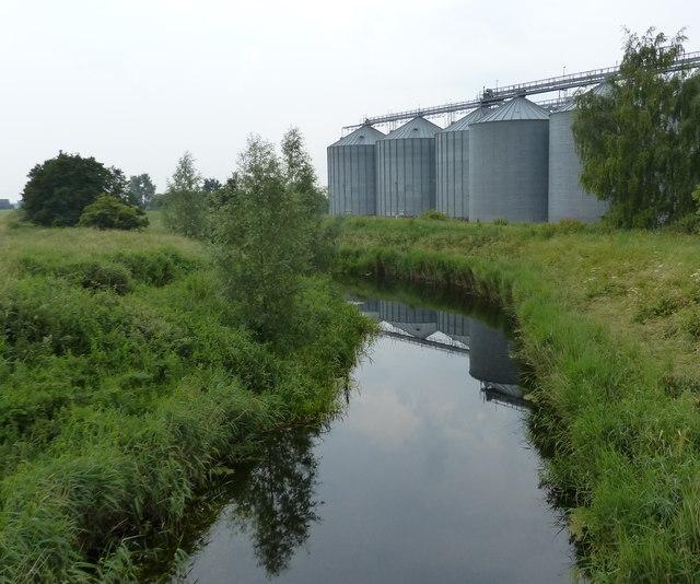 Grain storage silos next to the River Nar