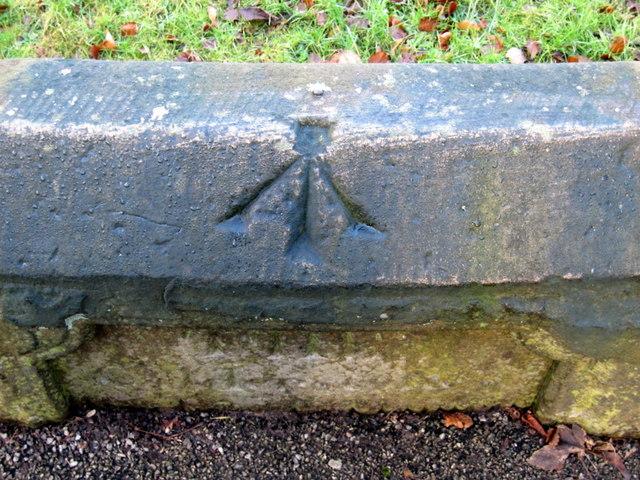 Rivet bench mark on the Calderstones surround
