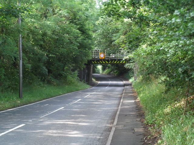 Low railway bridge on the A5104