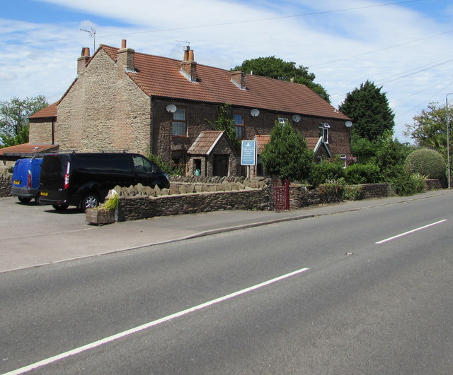 Row of four houses at the northern edge of Westerleigh