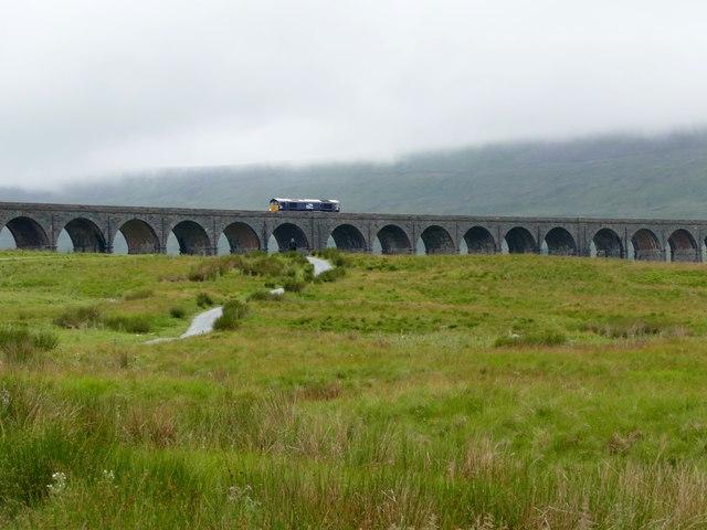 Diesel locomotive crossing the Ribblehead Viaduct