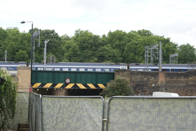 View of a Class 374 Eurostar crossing the Camley Street bridge from Camley Street Nature Park