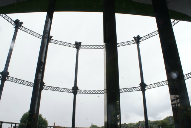 View of mirrors lining up with the columns on the gasholder from Gasholder Park