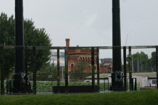 View of St. Pancras Water Tower framed by mirrors in Gasholder Park