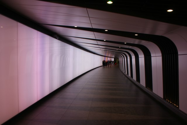View along the tunnel into Kings Cross St Pancras tube station from King's Boulevard