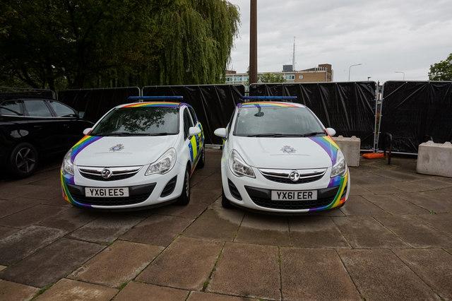 Two Police cars make one rainbow